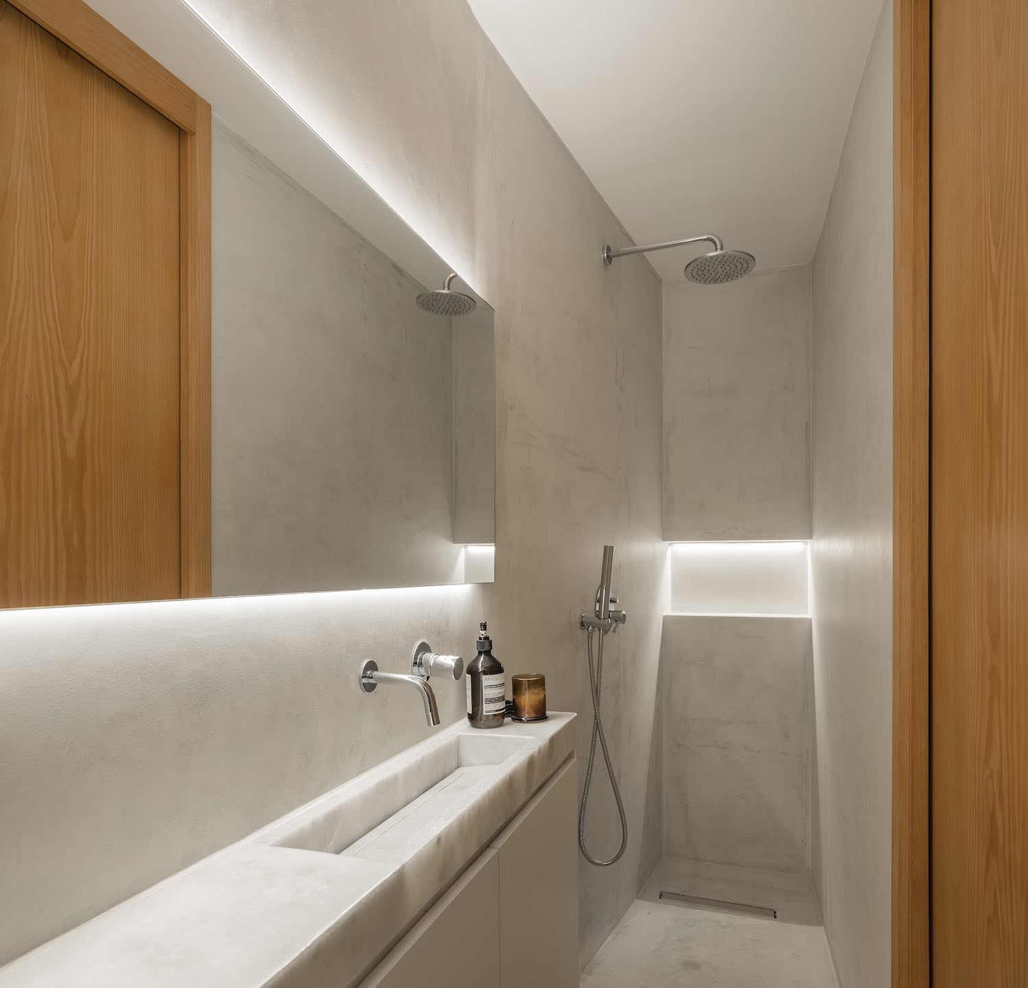 bathroom with shower and ceramic walls
