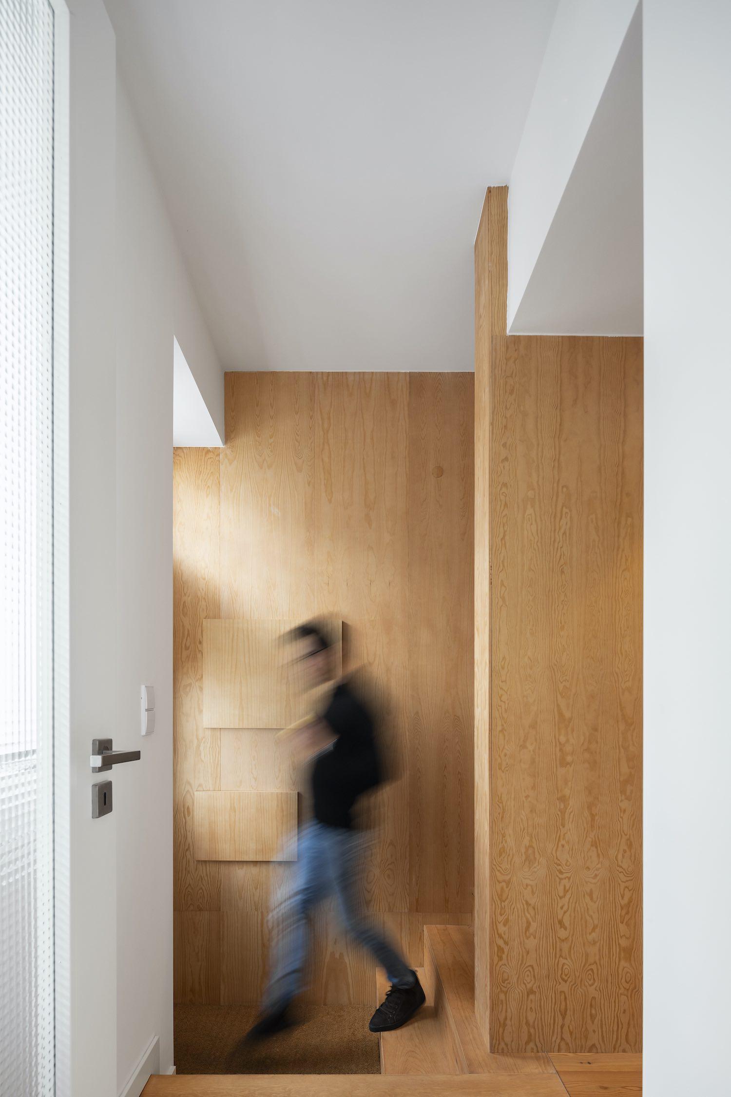 man walking toward the door
