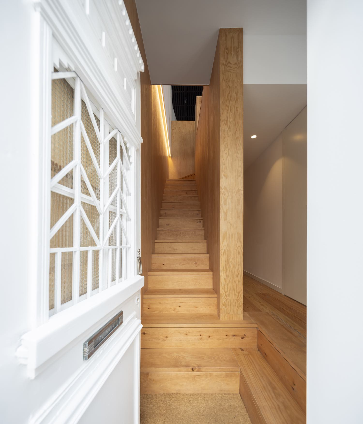 staircase located at the entry fo the house