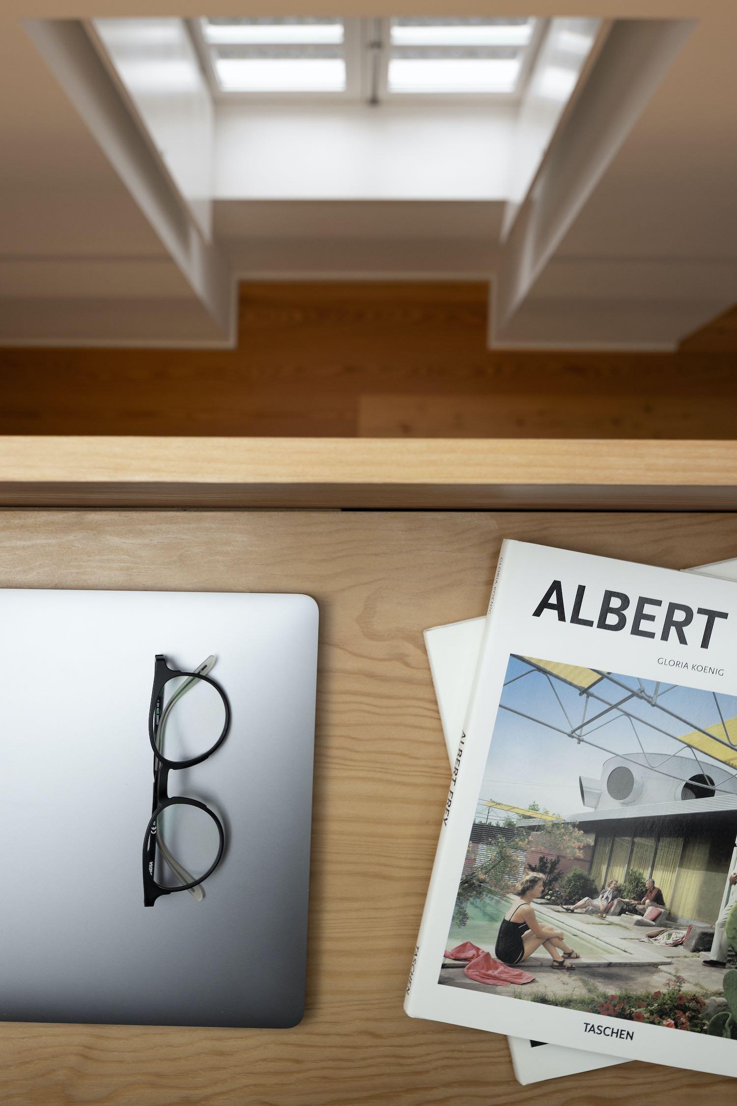glass, MacBook and books