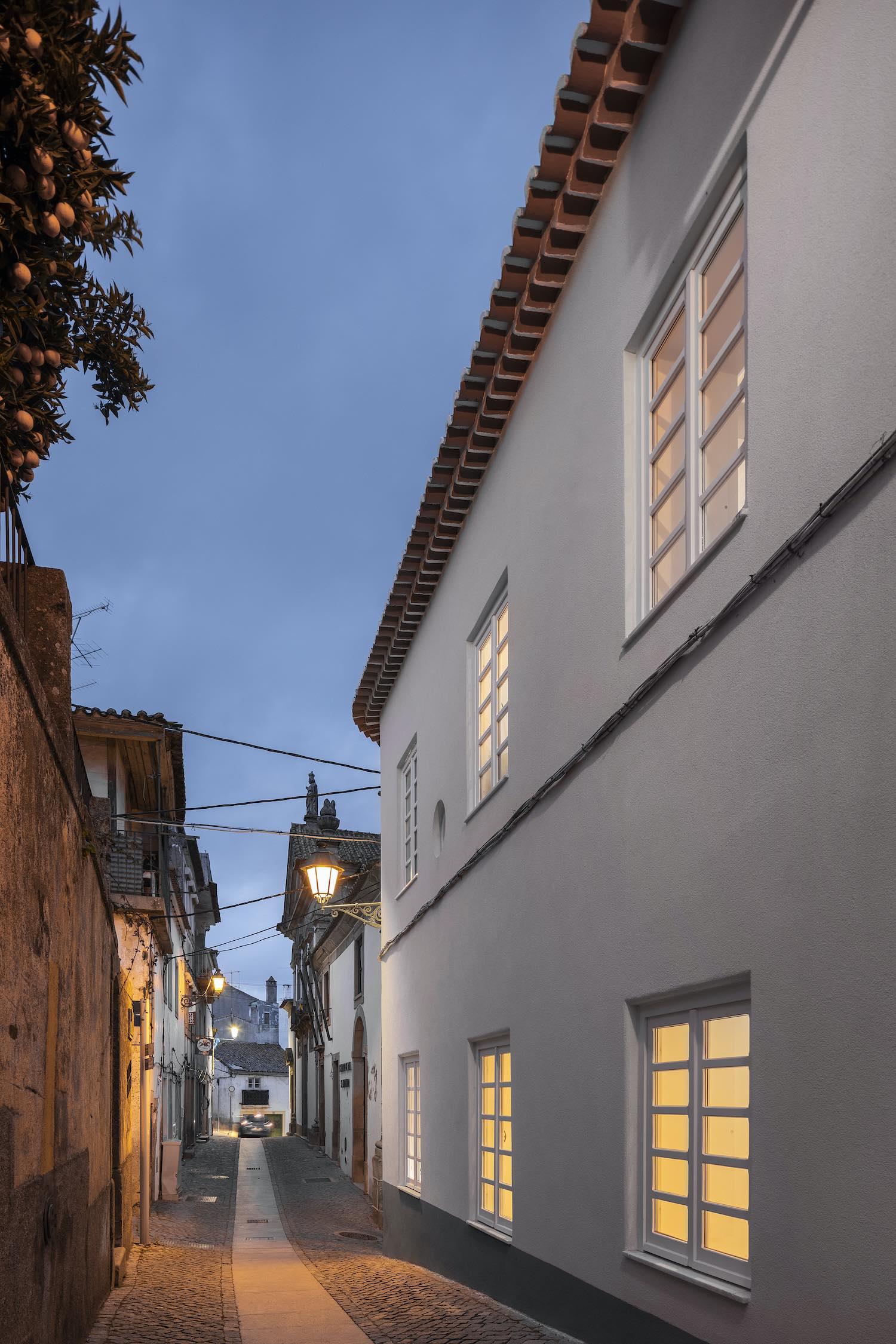 narrow alley with illumination at night