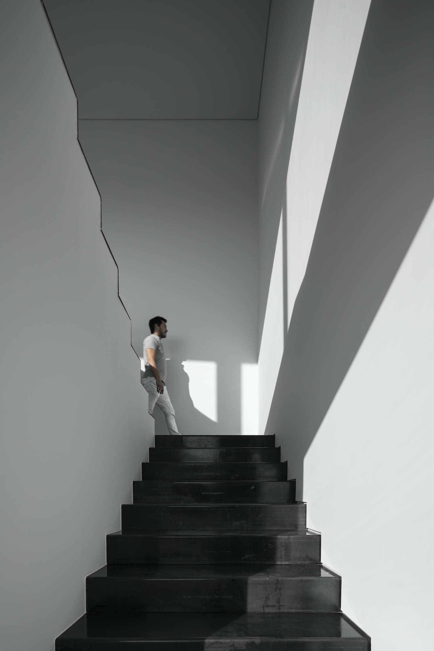 man walking on the staircase