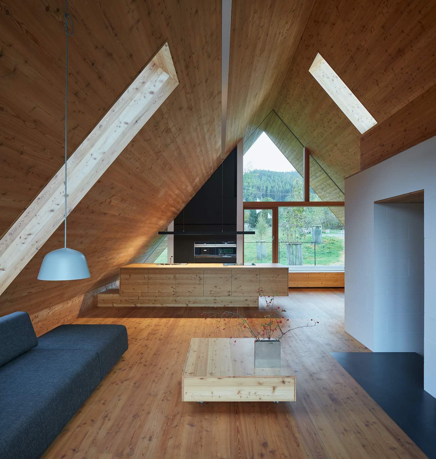 a modern kitchen in a triangular wooden cottage