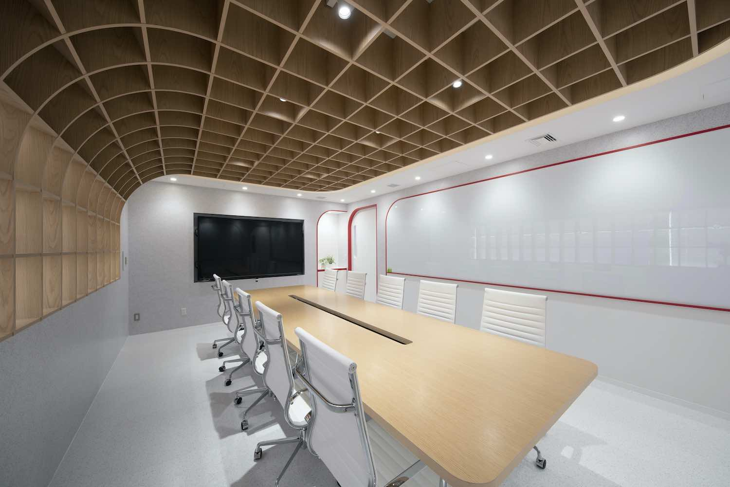 a white meeting room with wooden ceiling