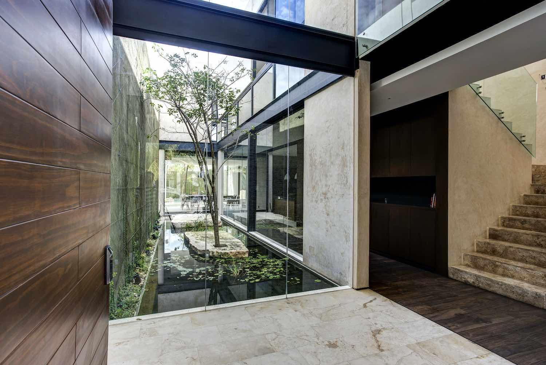 indoor garden with tress and water