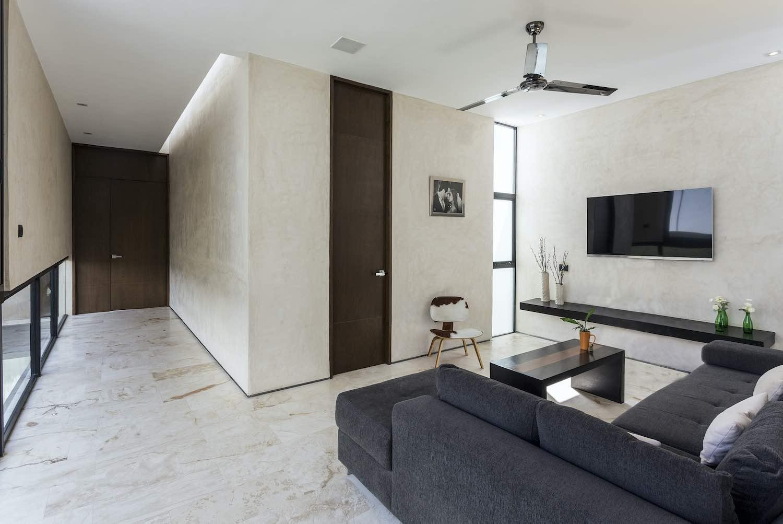 L shape dark grey sofa at living area