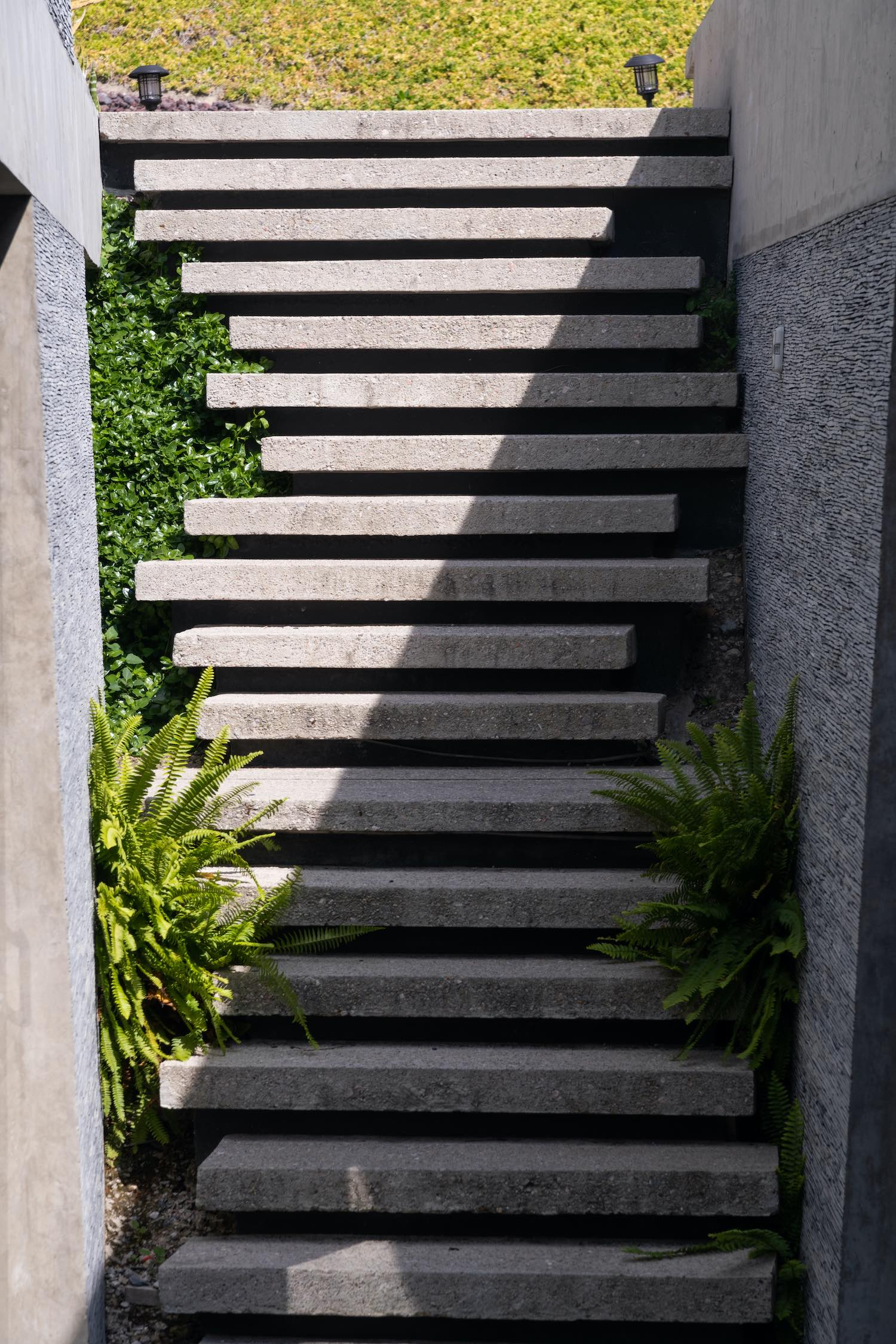concrete steps connecting different part of the house