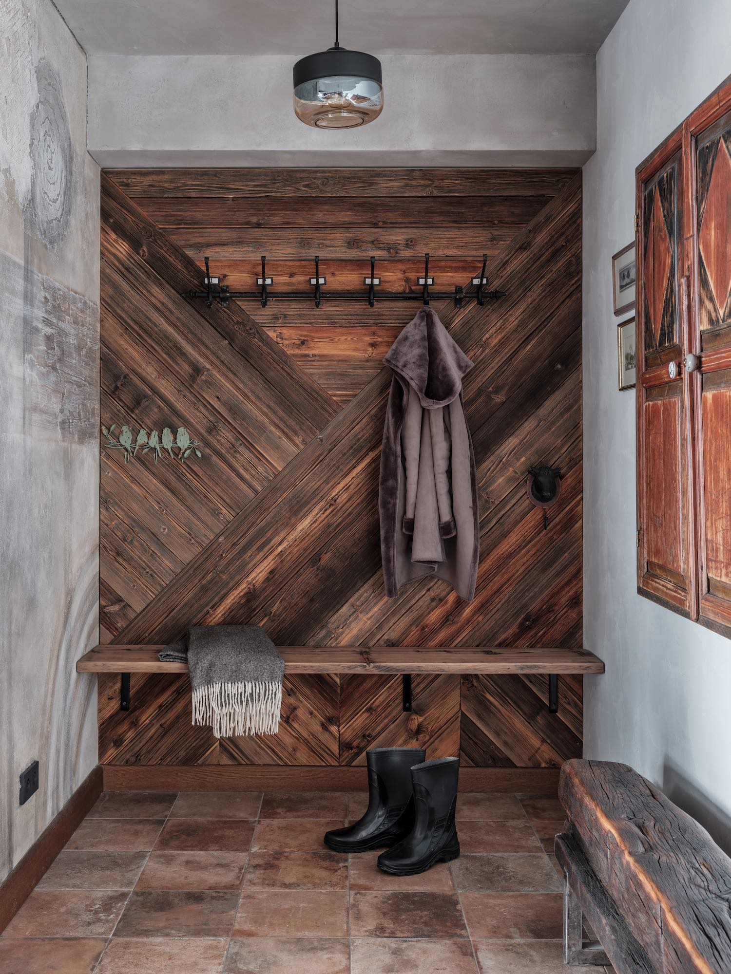 wooden wall and hangers for the clothes