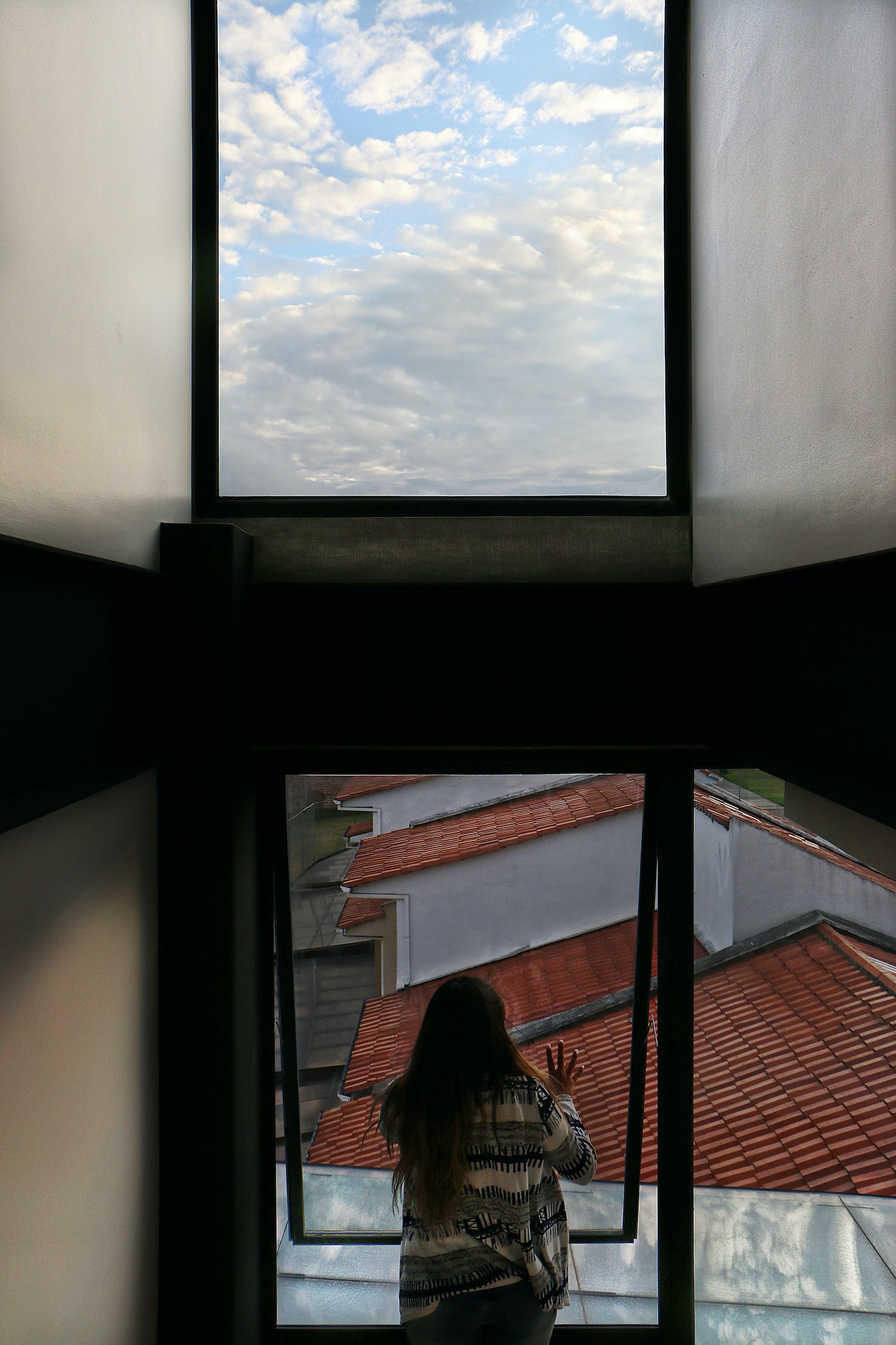 a girl opening the glass window