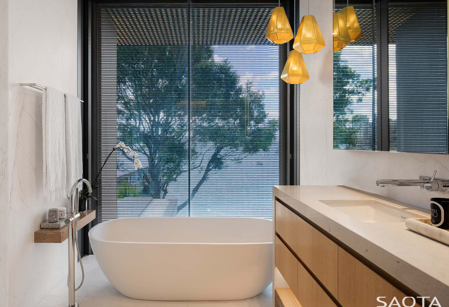 a beautiful van in bathroom illuminated with yellow pendant lamp