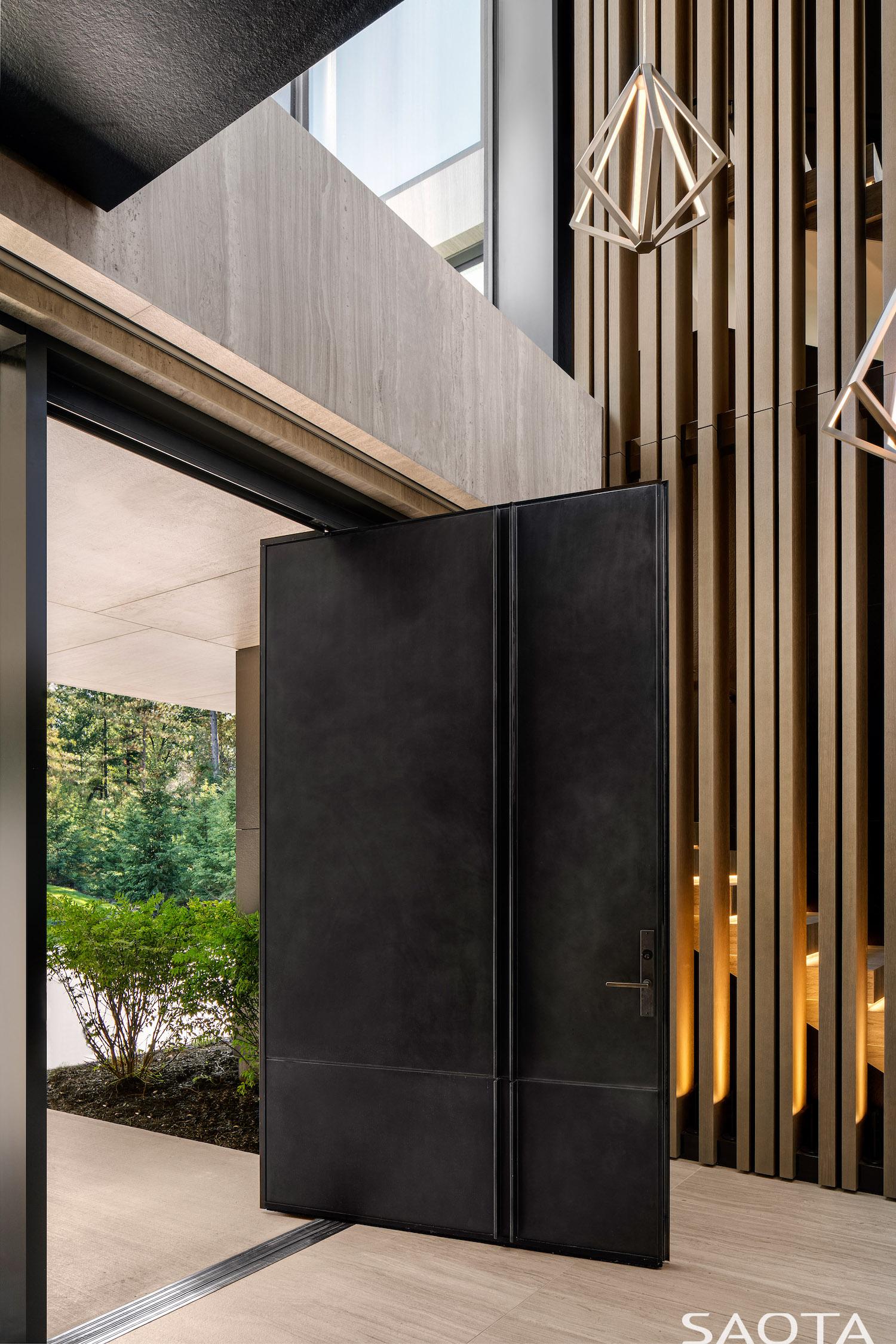 large metallic pivot door