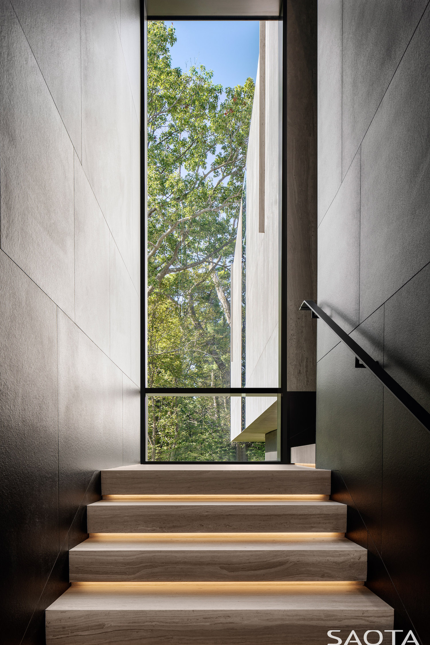 sunlight hitting the staircase through vertical window