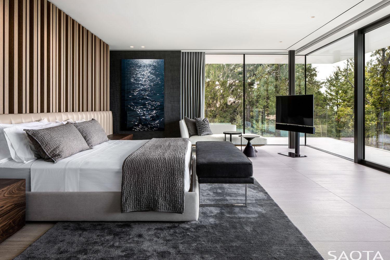 luxury bedroom with large windows