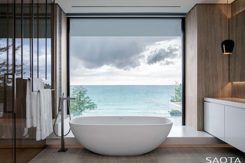 bathtub near window with great sea view