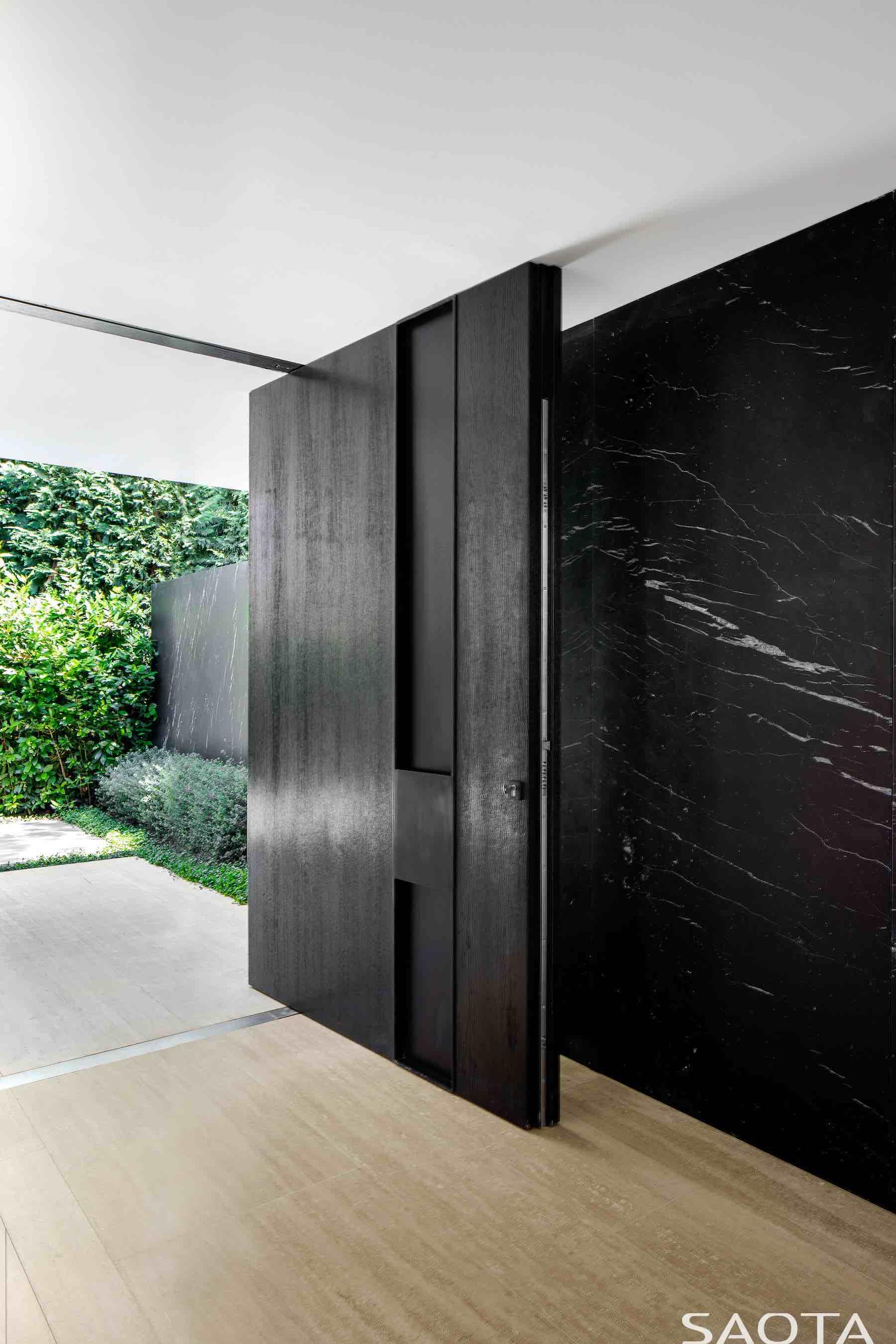 huge wooden black door