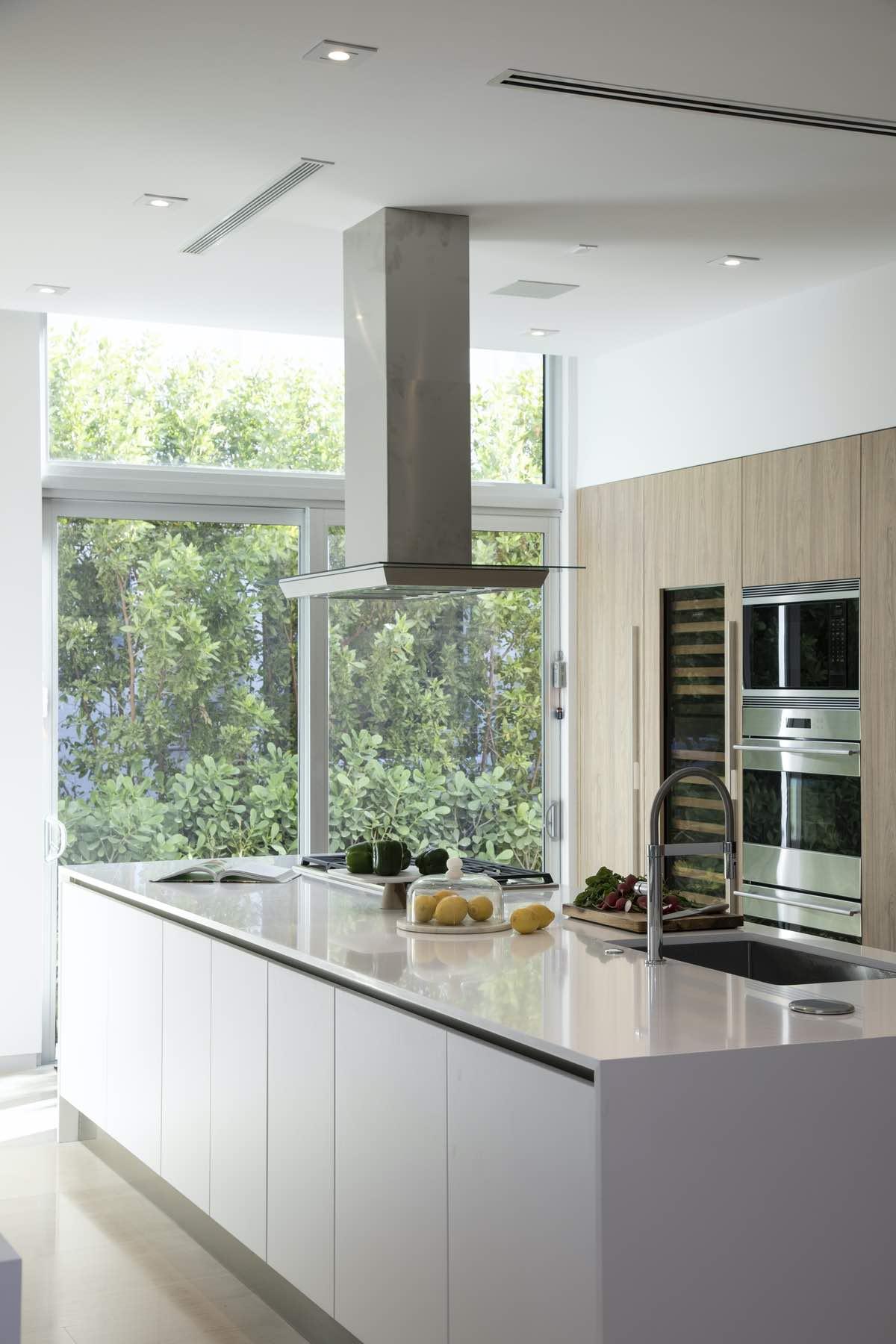 glossy kitchen with big glass windows
