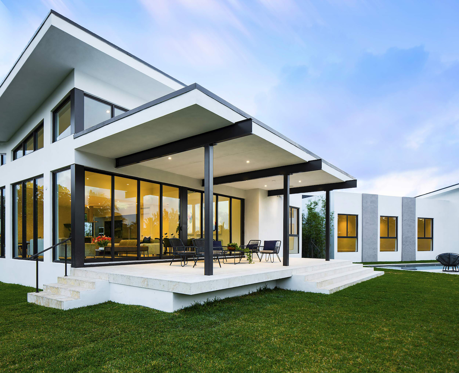 modern house in Miami surrounded with green landscape