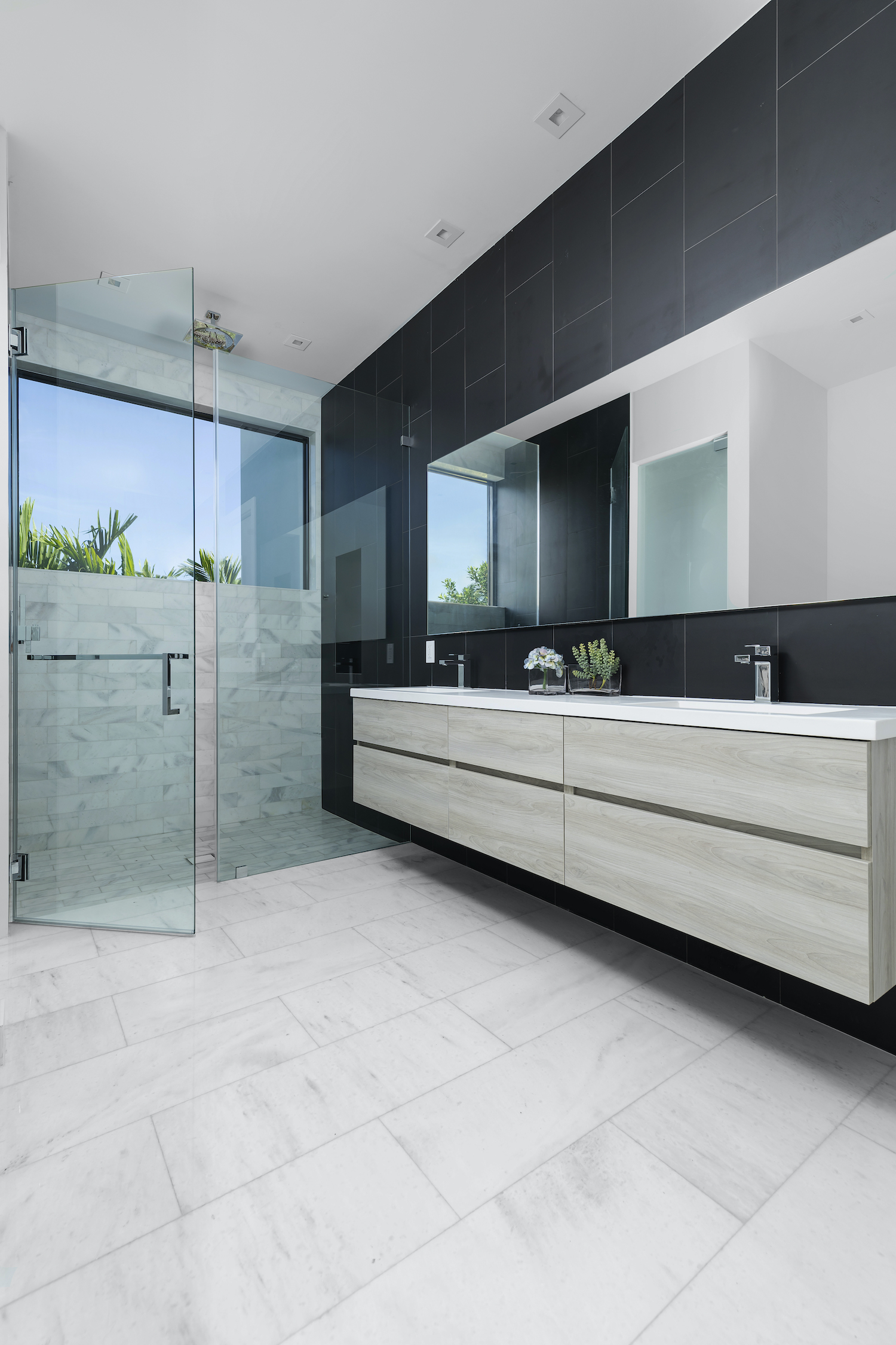 bathroom with glass door separate the washing space form bath