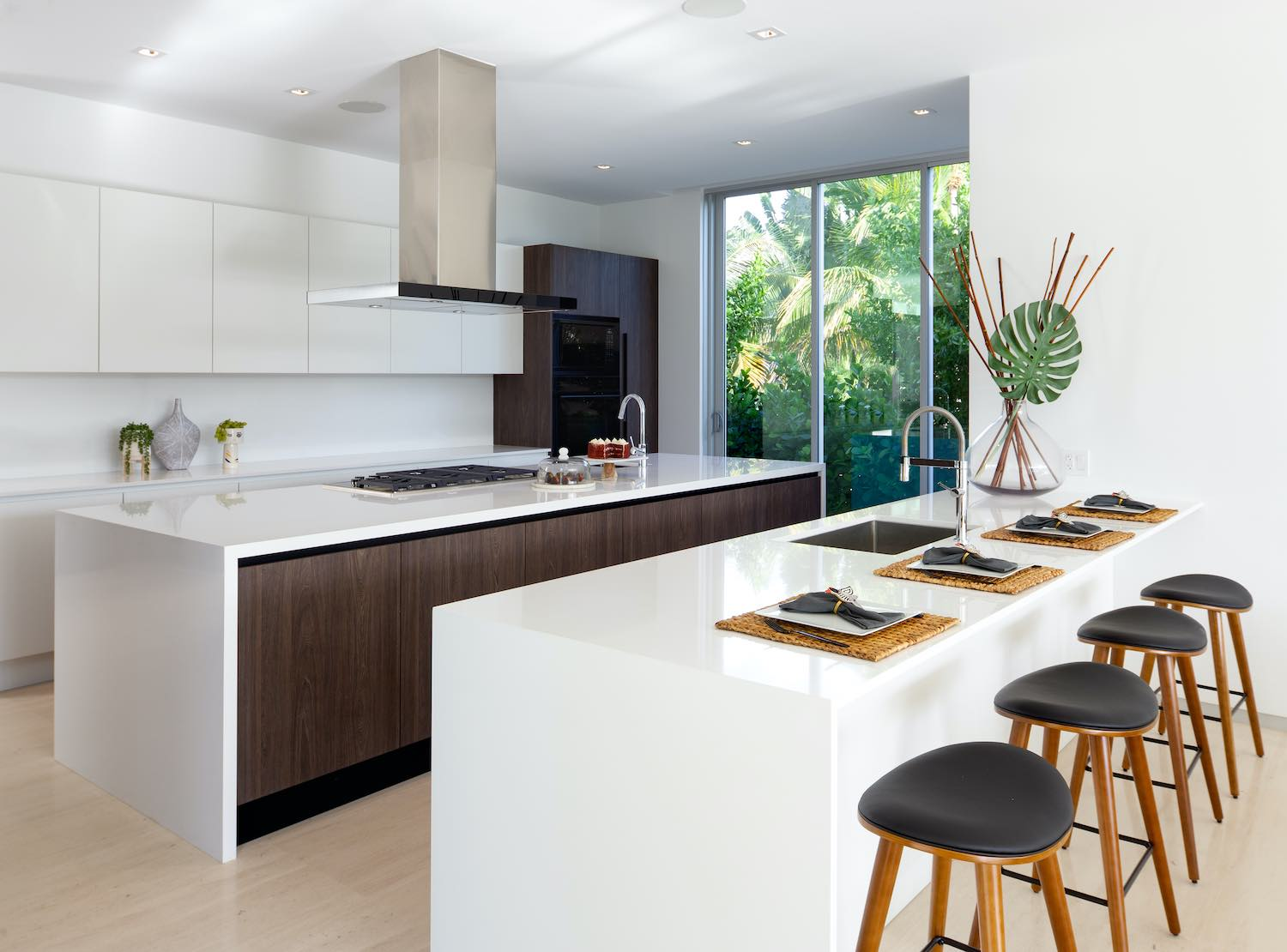 modern white kitchen with bar stools