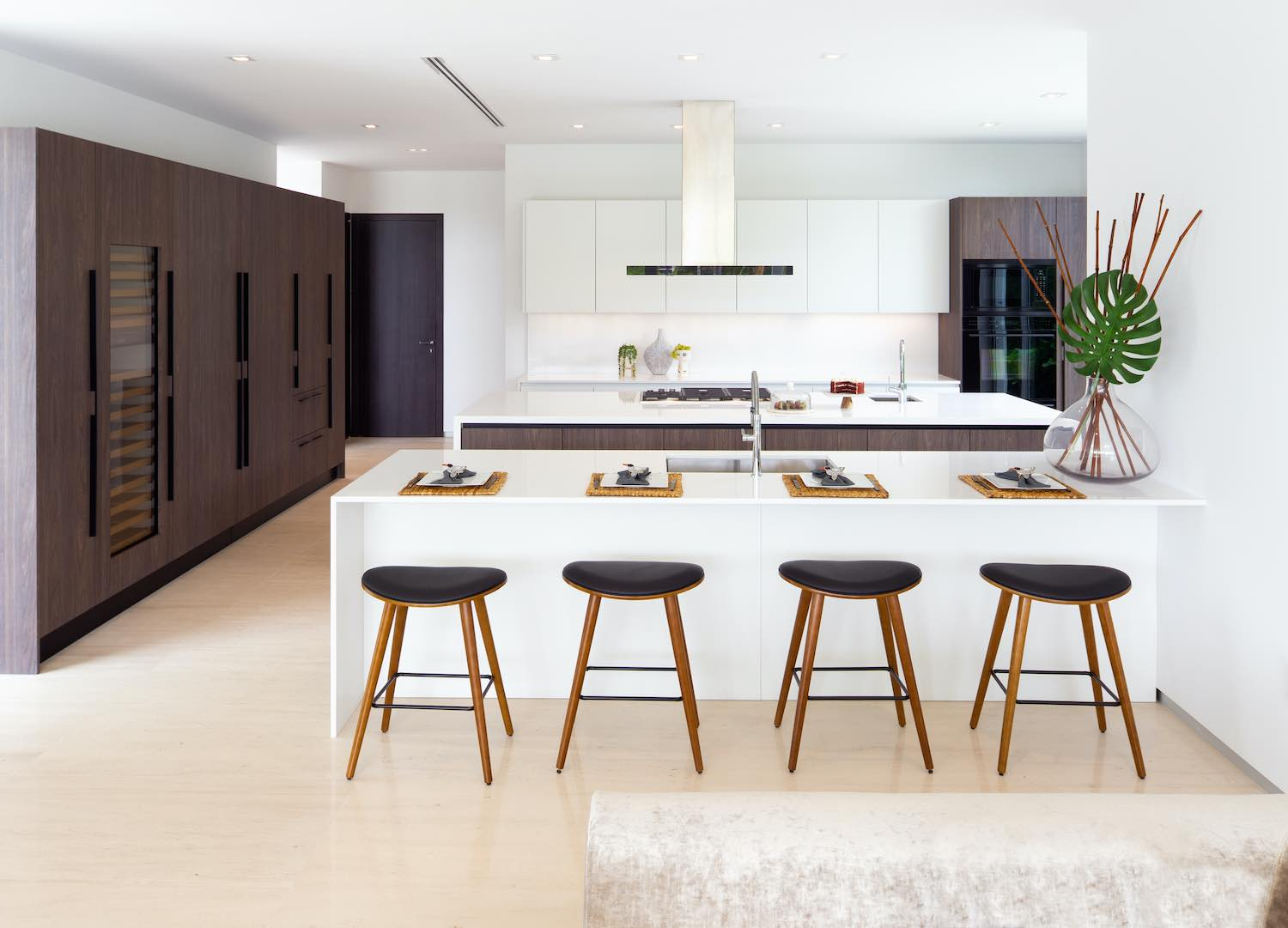 modern white kitchen with stools
