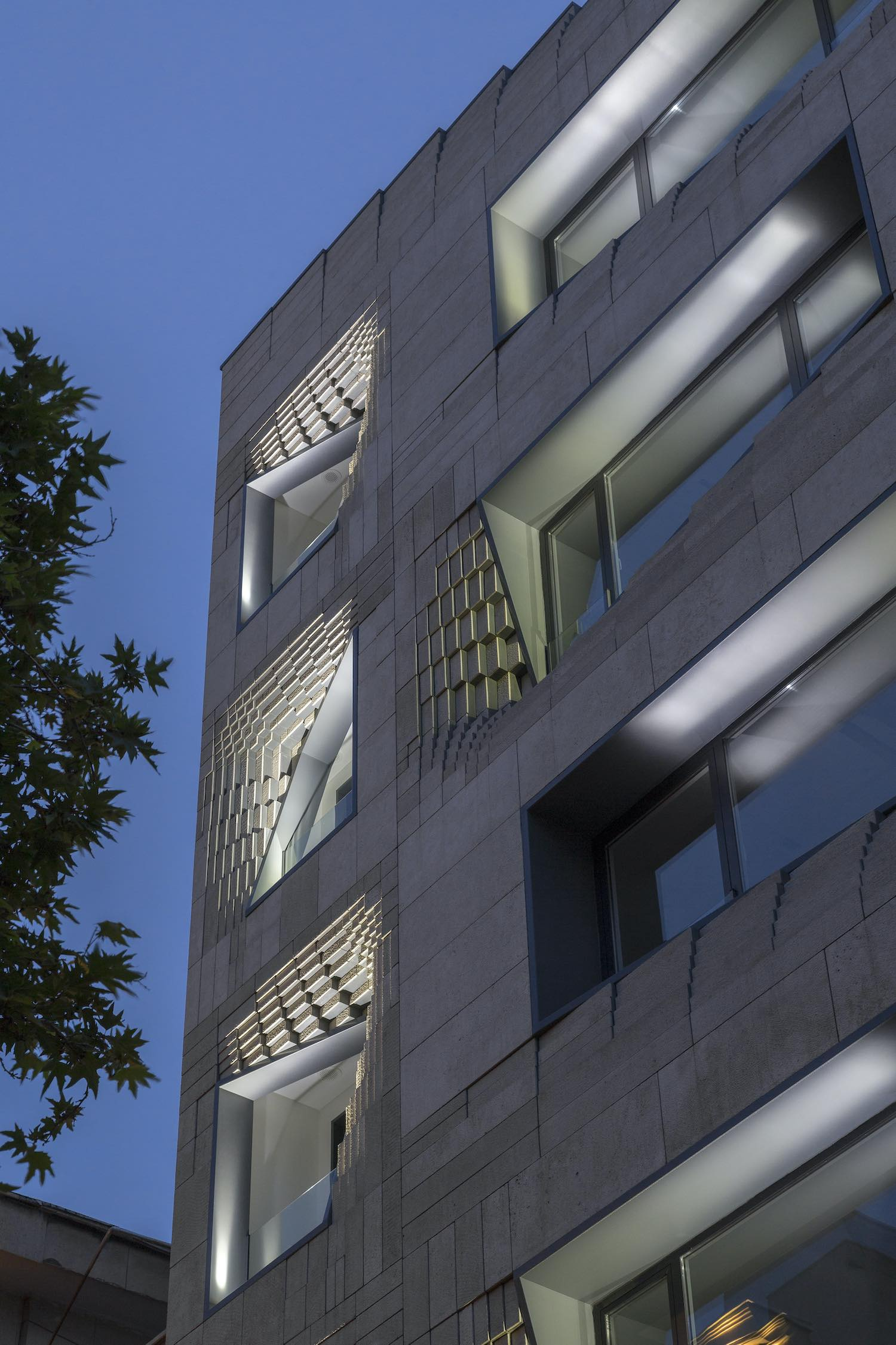 the windows in the facade illuminated with light