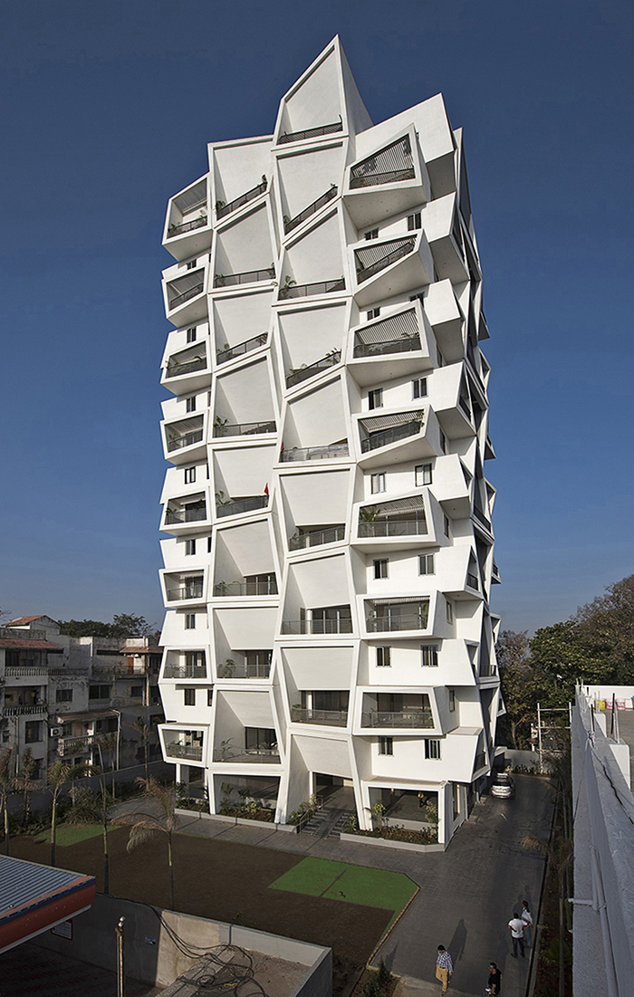 Apartment with large angled balconies by Sanjay Puri Achitects