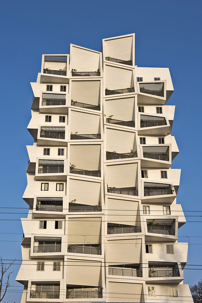 Apartment with large angled balconies by Sanjay Puri Achitects in India