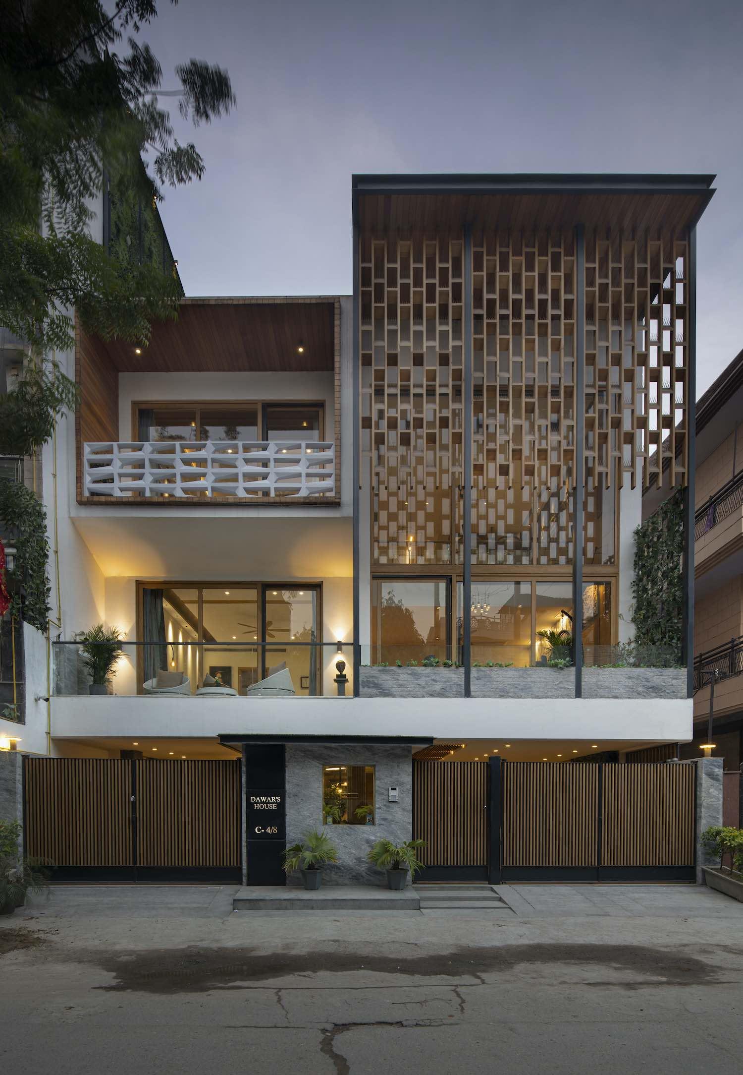a house with screen wooden facade