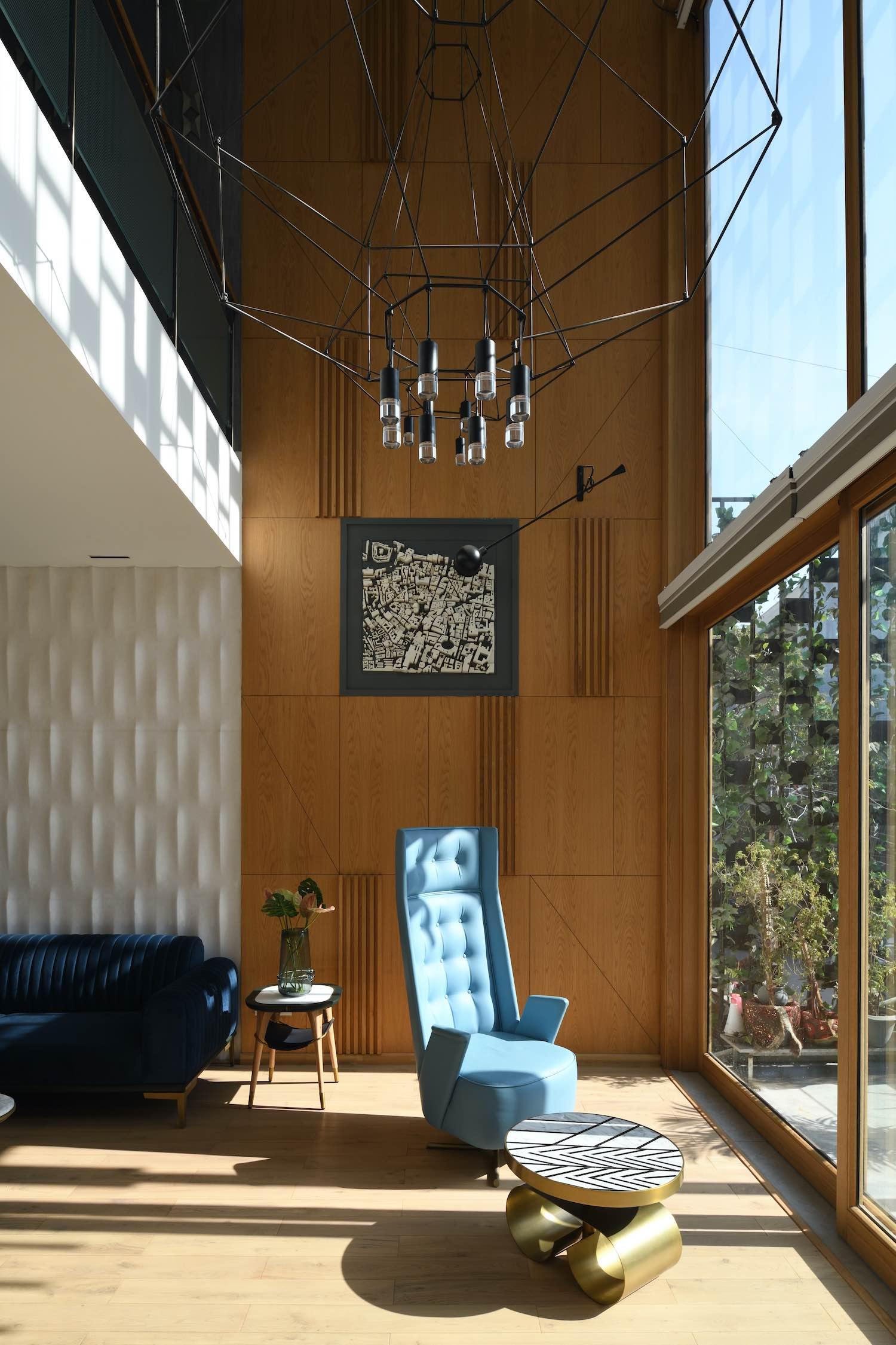blue chair and dark blue sofa