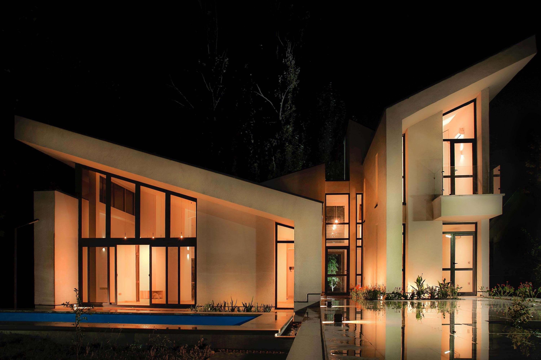 a house with beautiful illumination at night