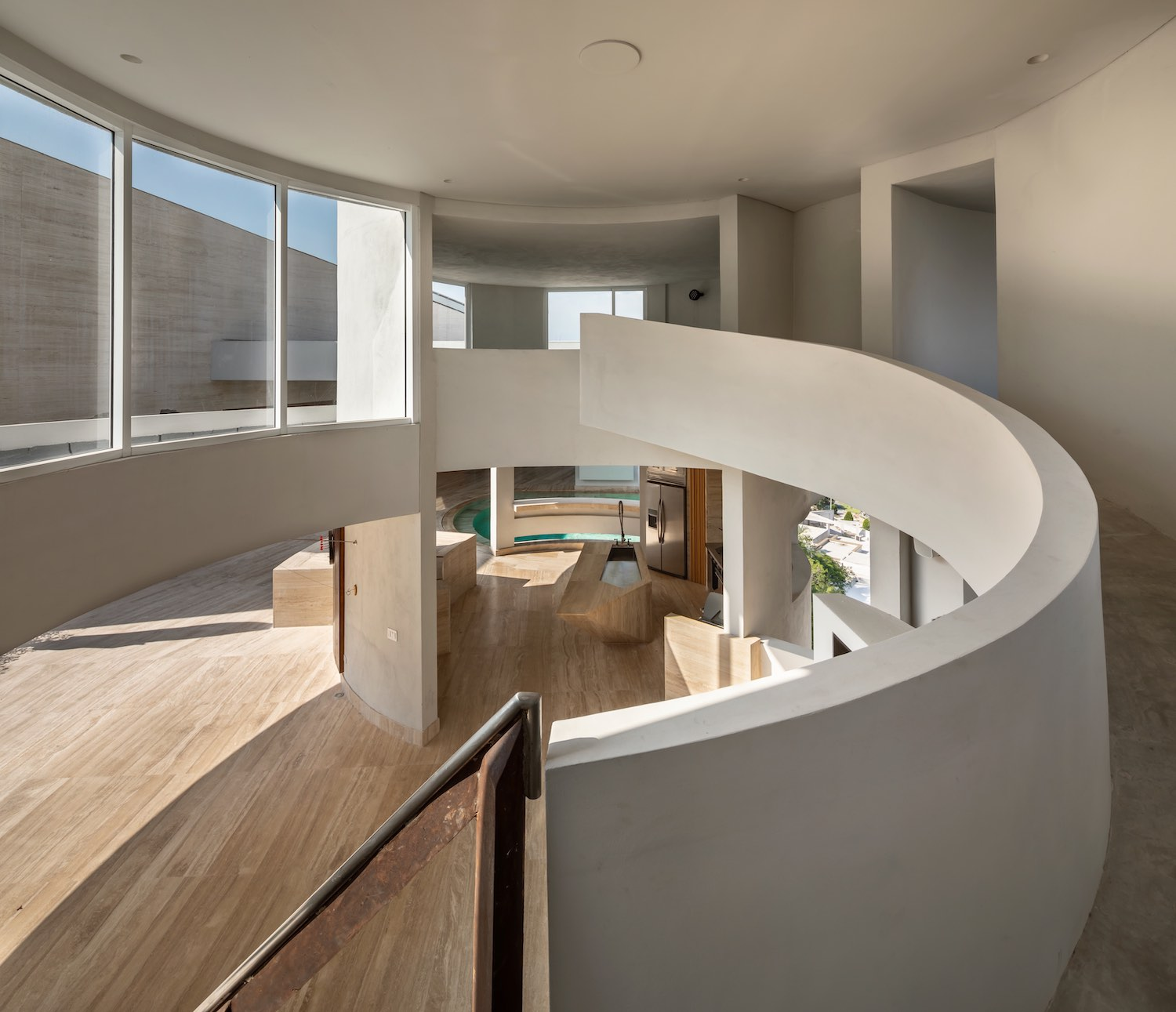 double volume space with circular staircase