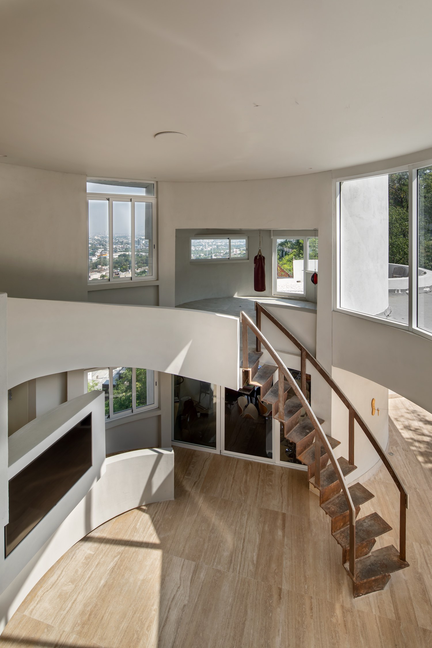 sunlight enters the house through windows in the ceiling