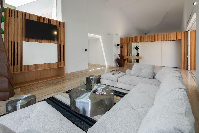 living room with metallic table and fabric sofa