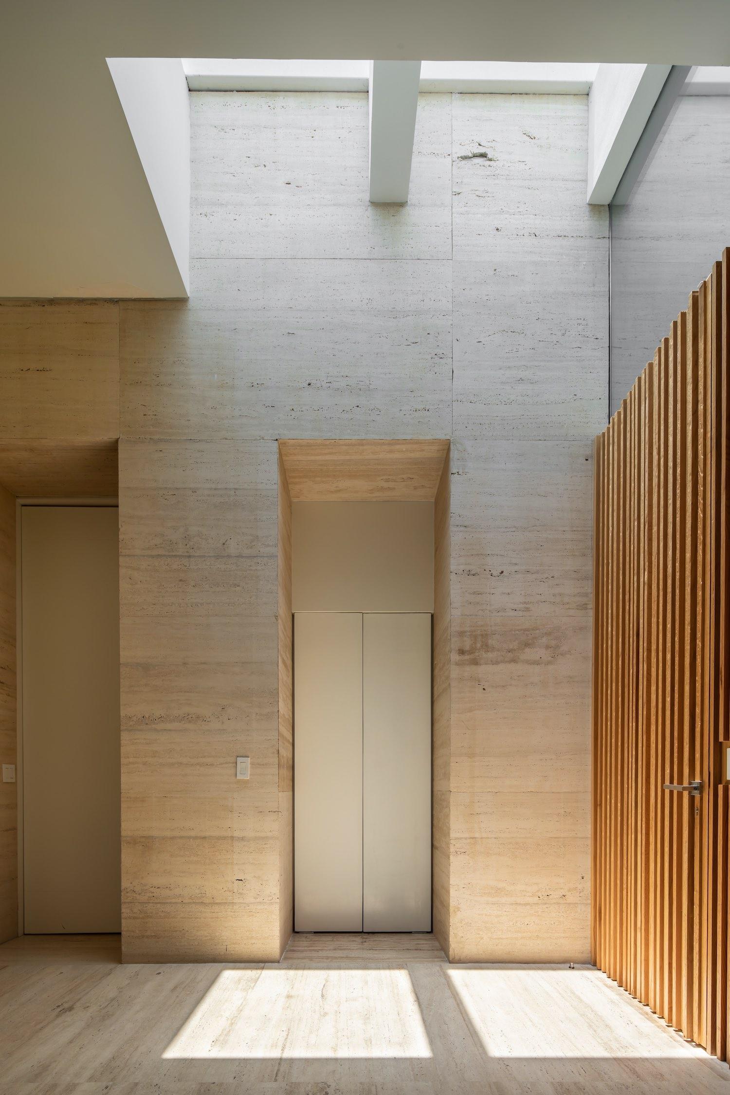 oak wood door and marble stone walls