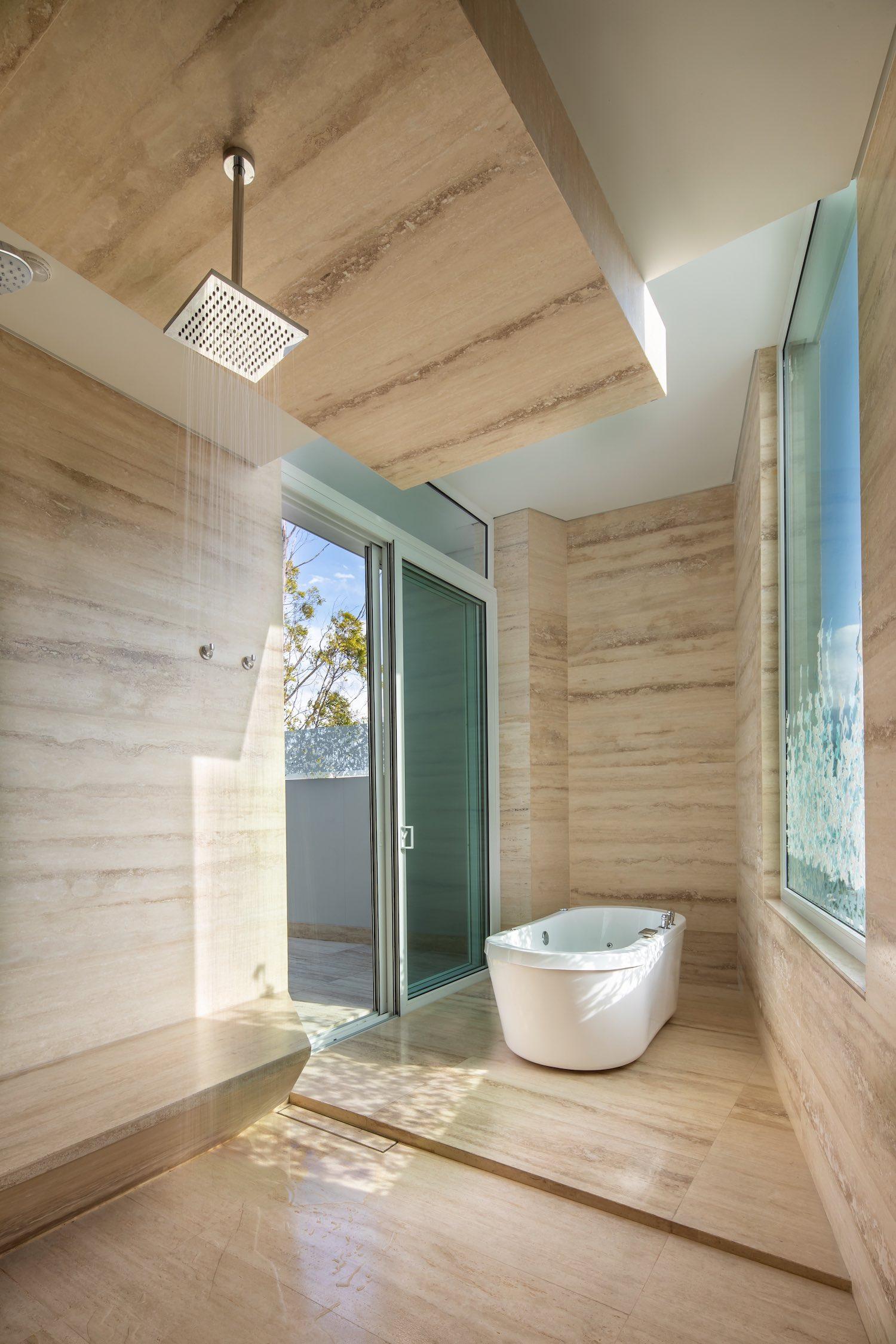 bathroom bathtub with open glass window