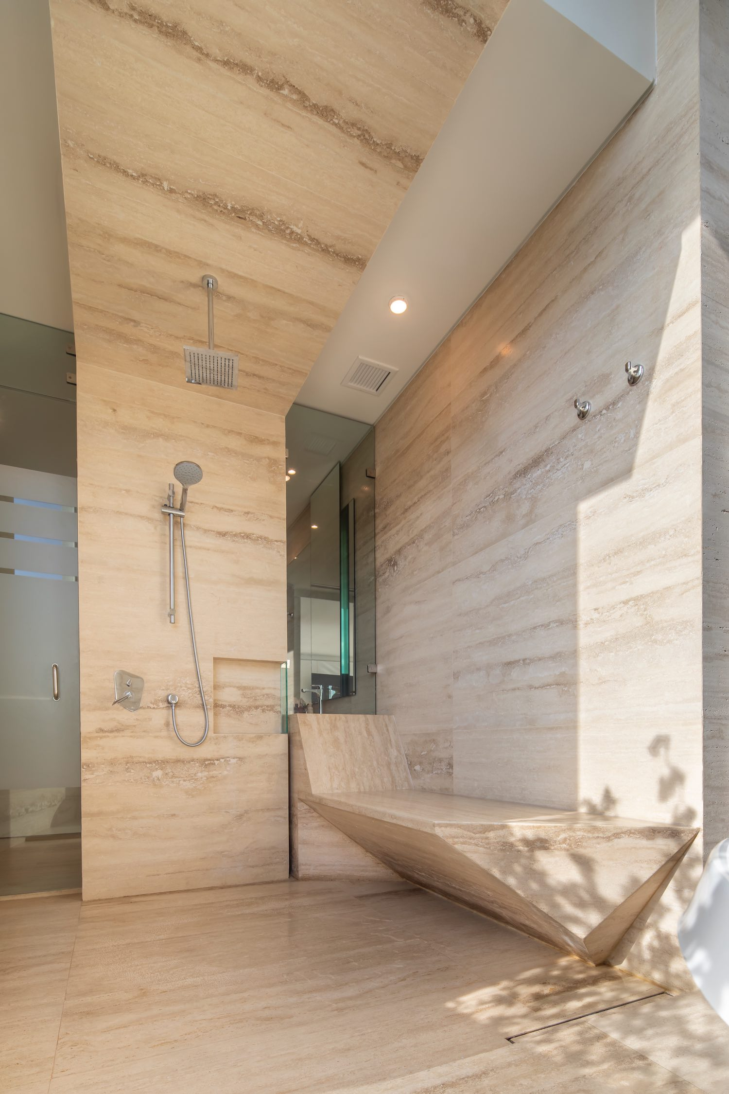 bathroom shower and marble stones walls and floor
