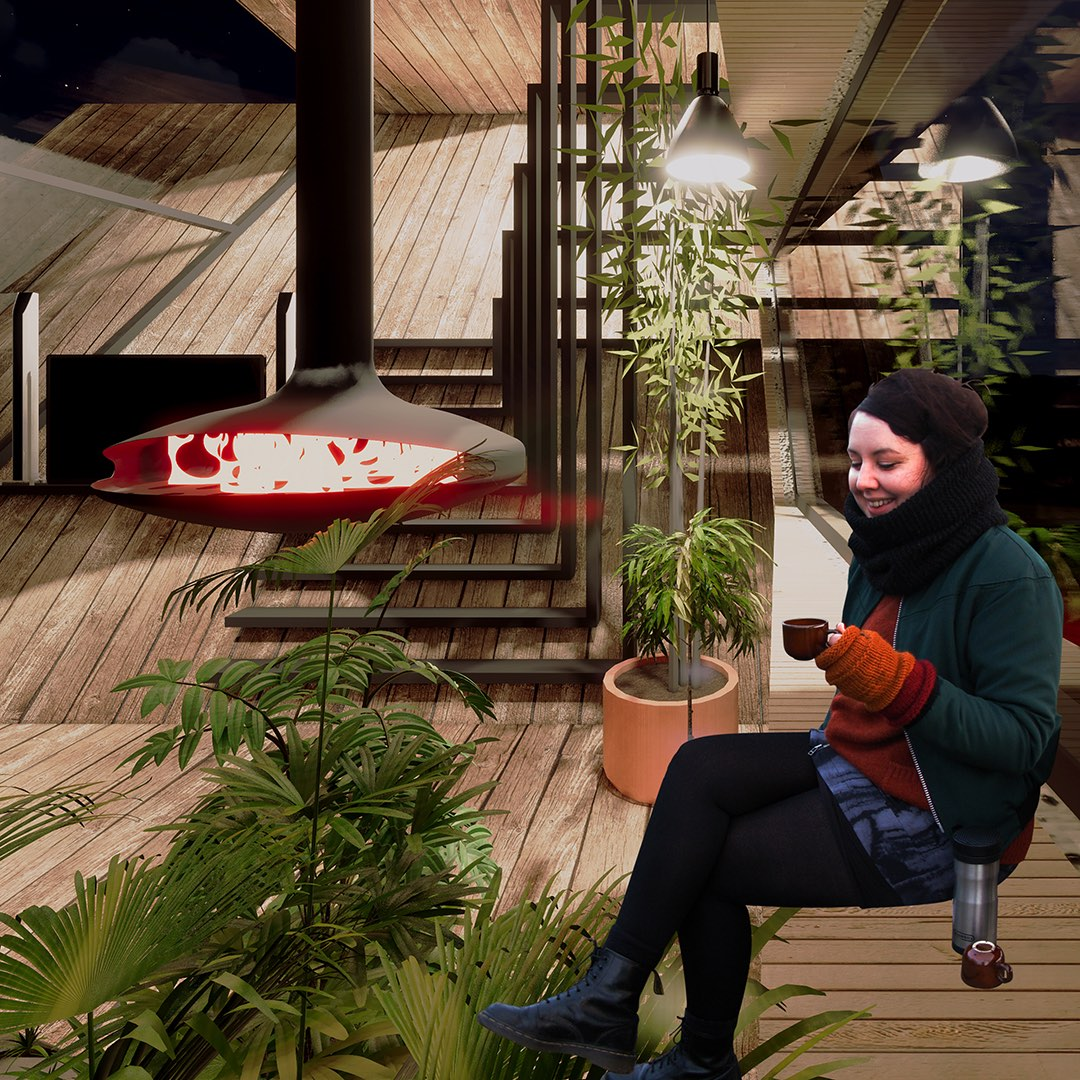 girl is taking coffee nearby fireplace inside cabin house