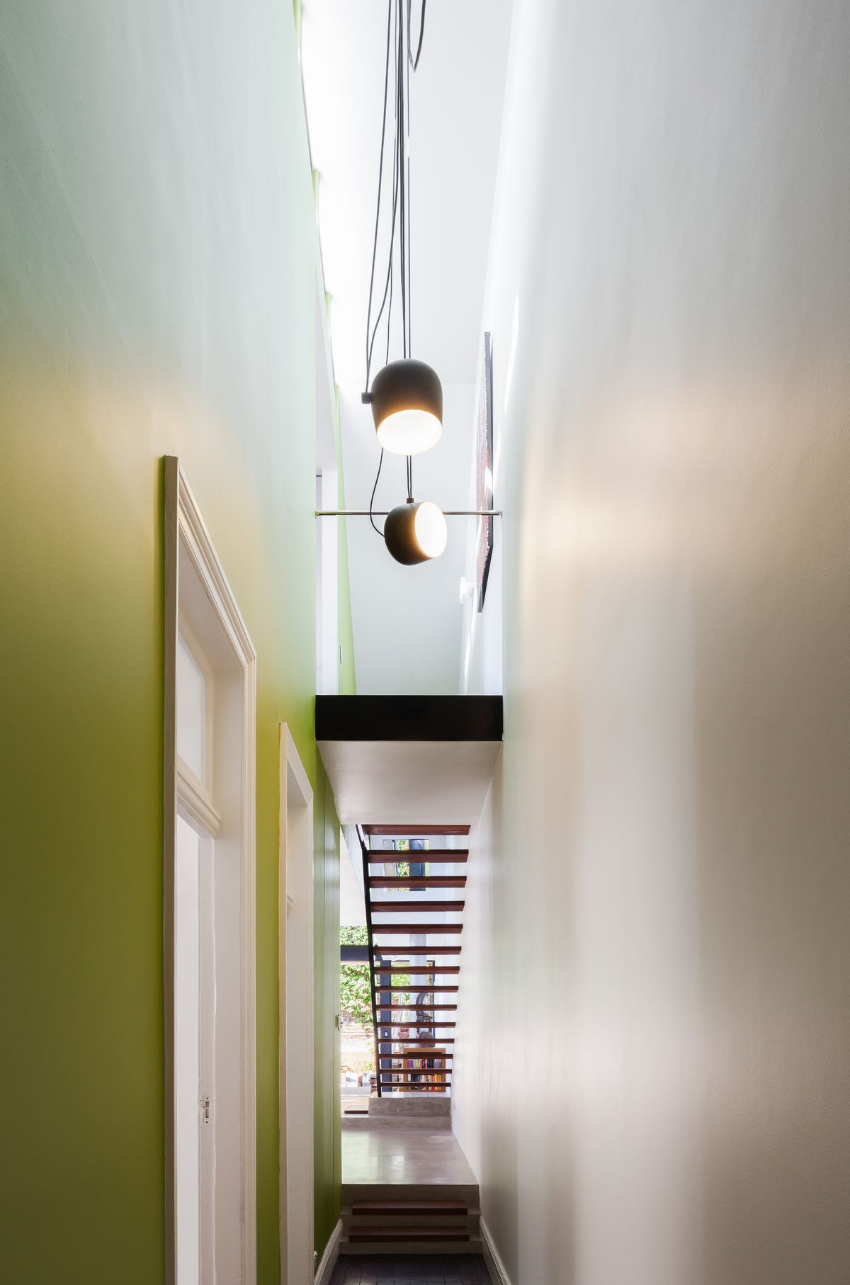 The large pendant lamp hanged over corridor
