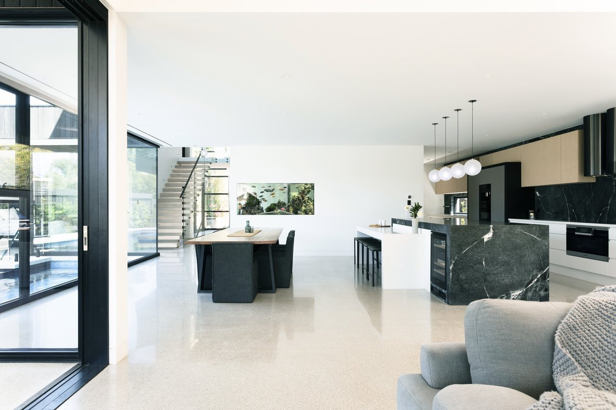 a modern black and white kitchen with big space area