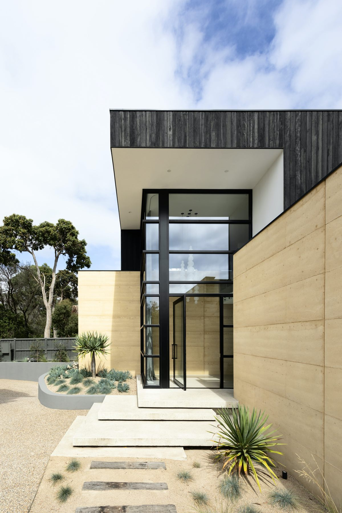 concrete steps with a beautiful landscape at the entrance door