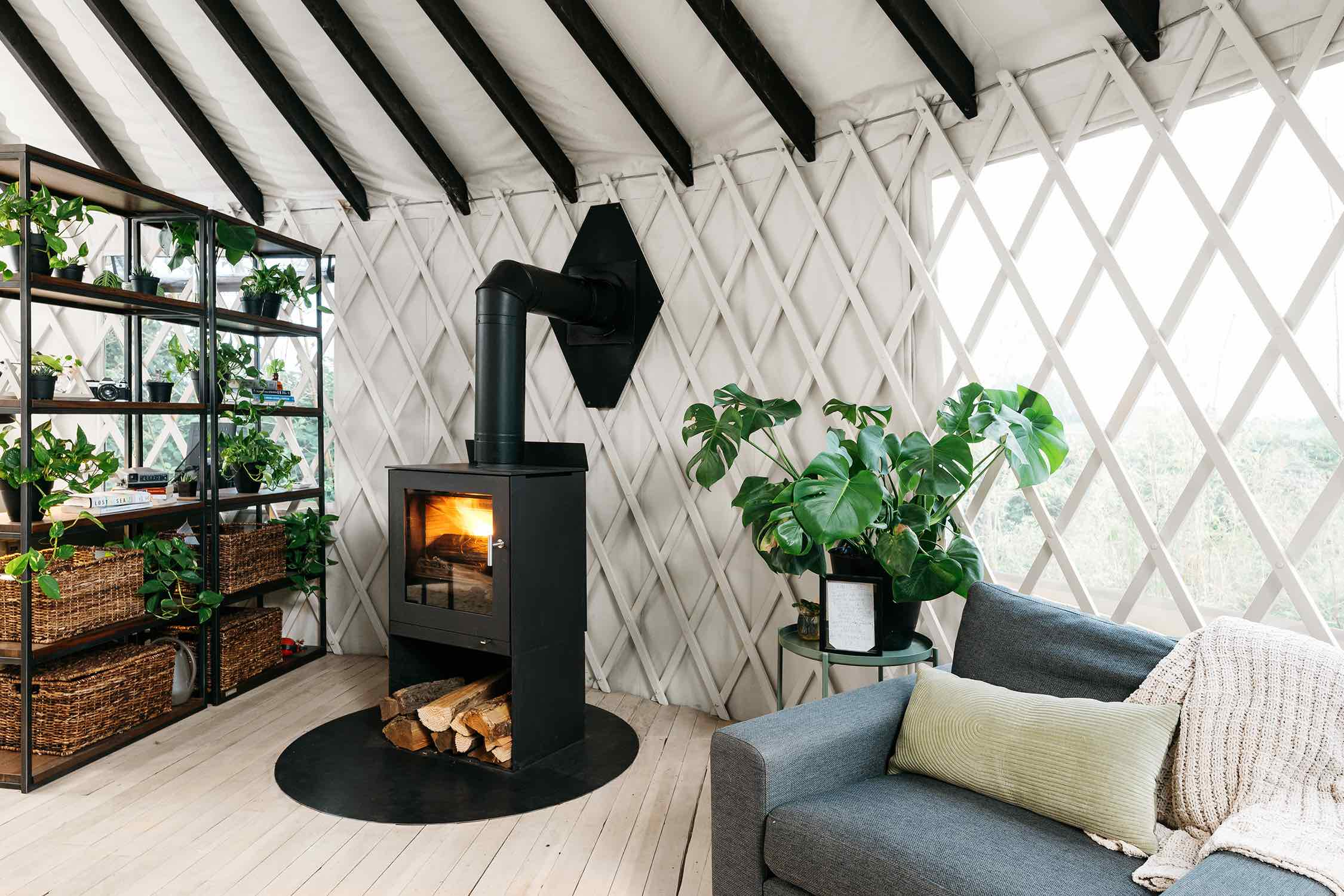 black metal fireplace with fore inside
