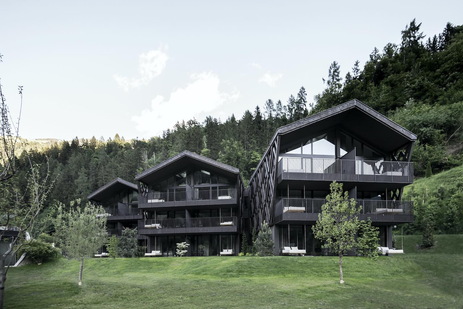 cottage shaped wellness and hotel in forest mountain
