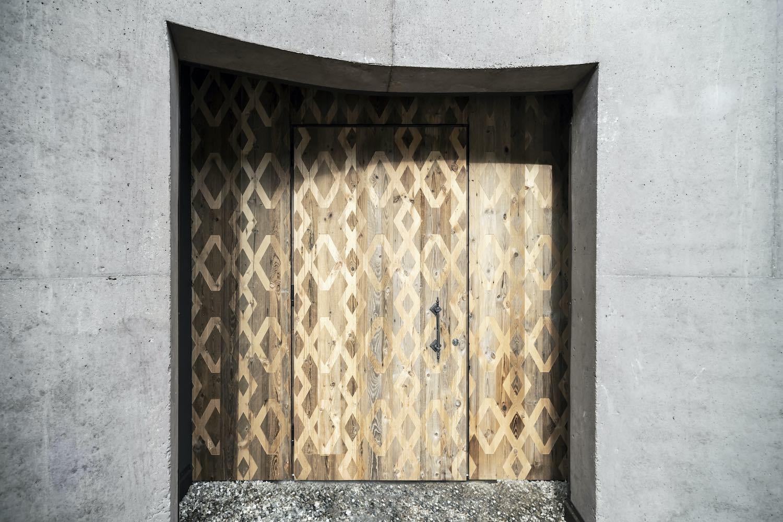 concrete wall and wooden door