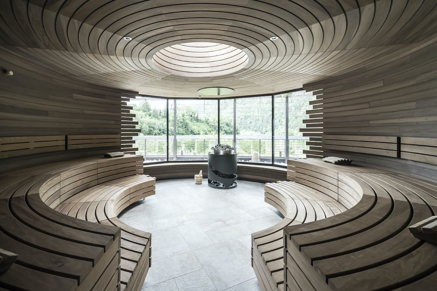 wellness room in circular shape with wooden benches
