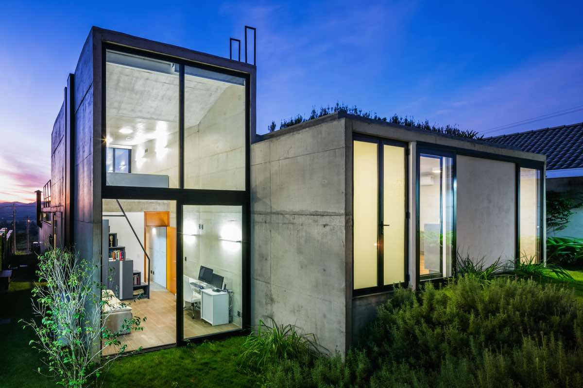 concrete home with large vertical windows