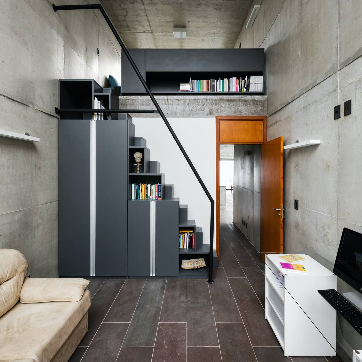 modern staircase that contains bookshelves