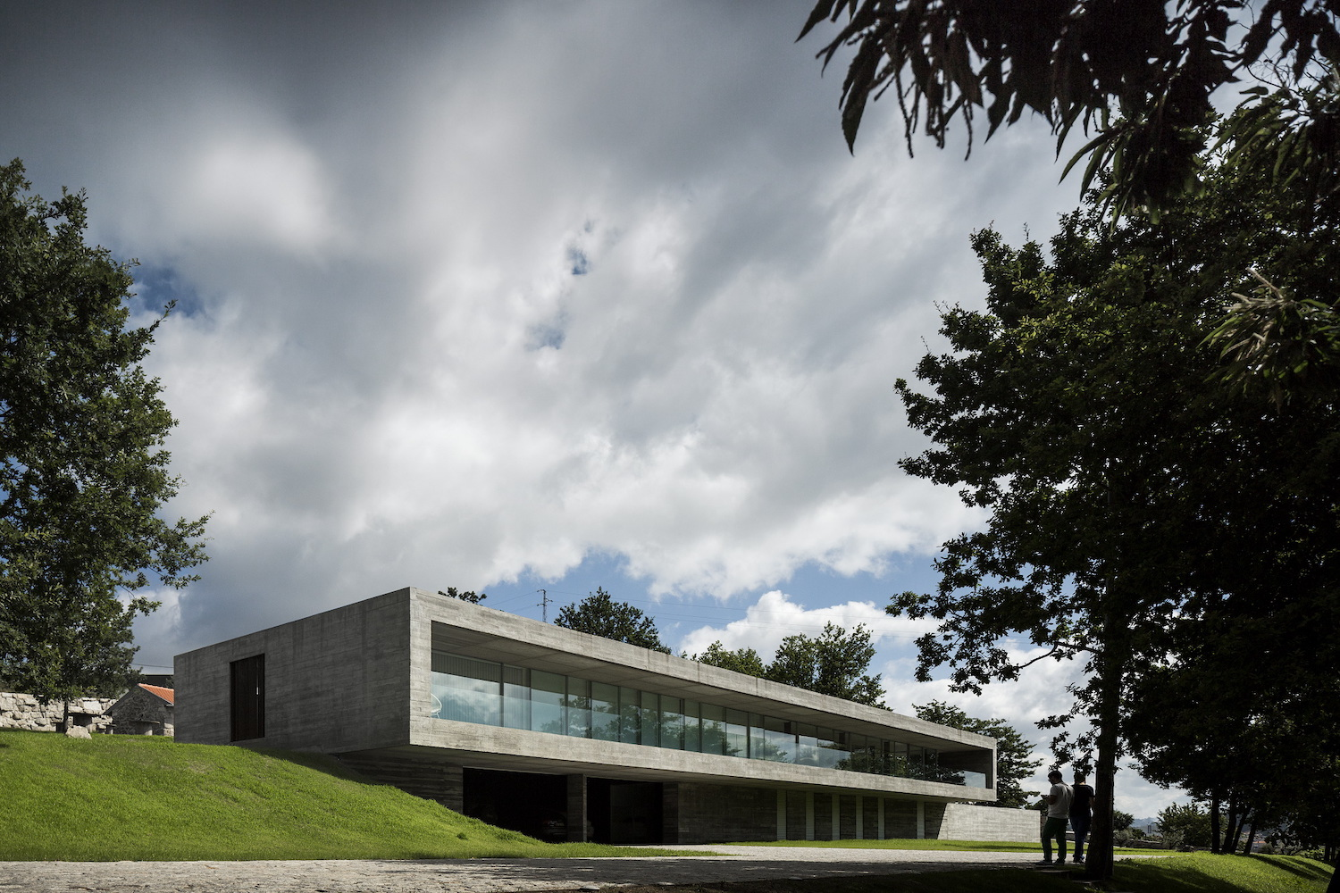 a concrete house in Portugal on green hill