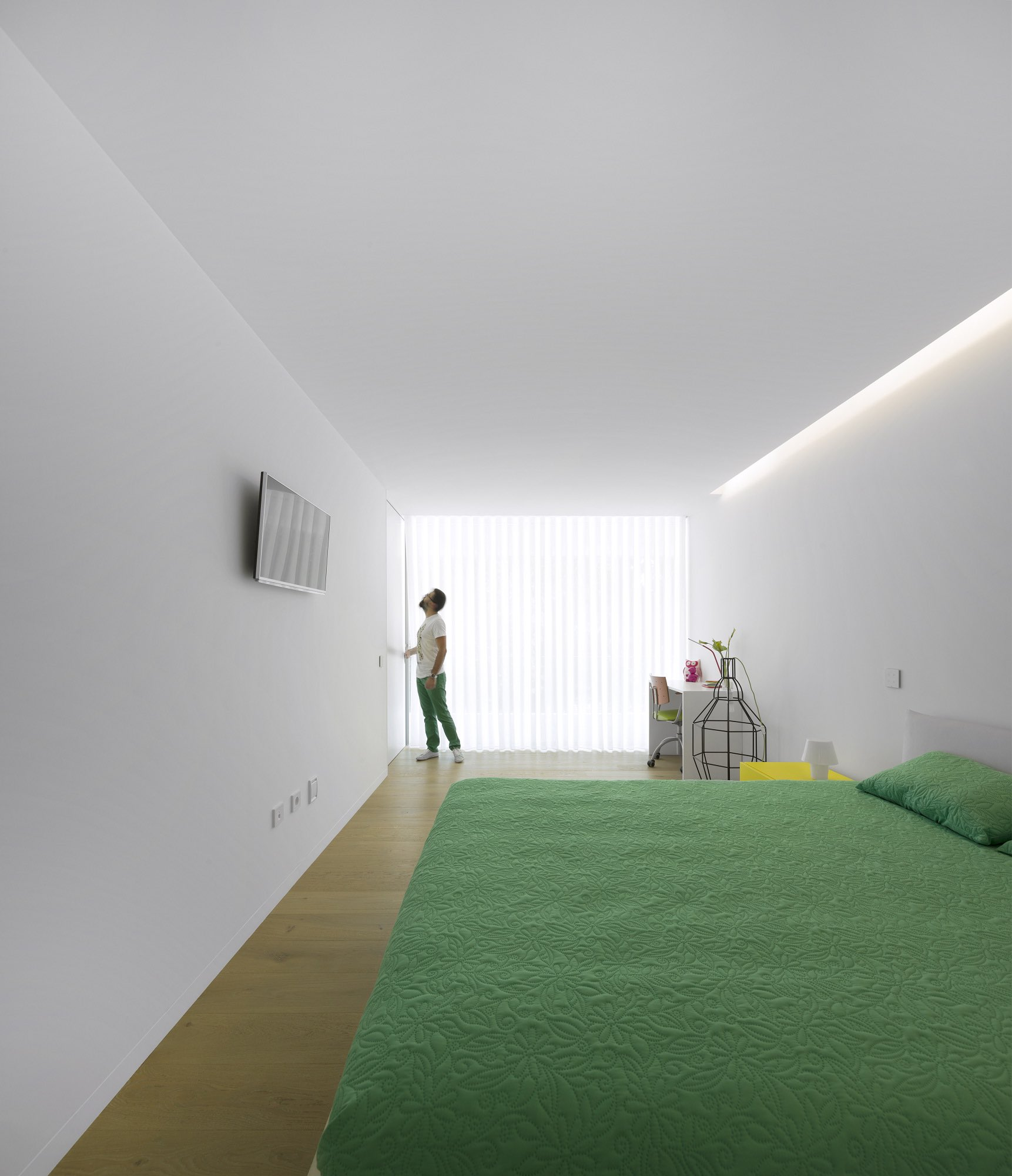 green bed in the bedroom
