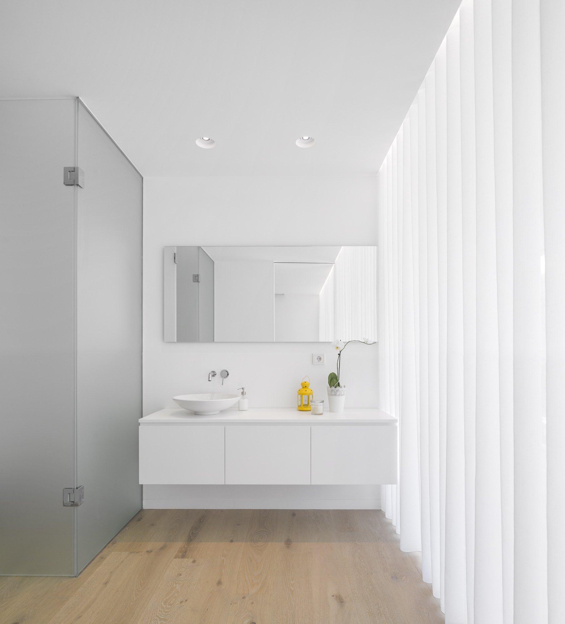 bathroom with white oval shaped washing basin
