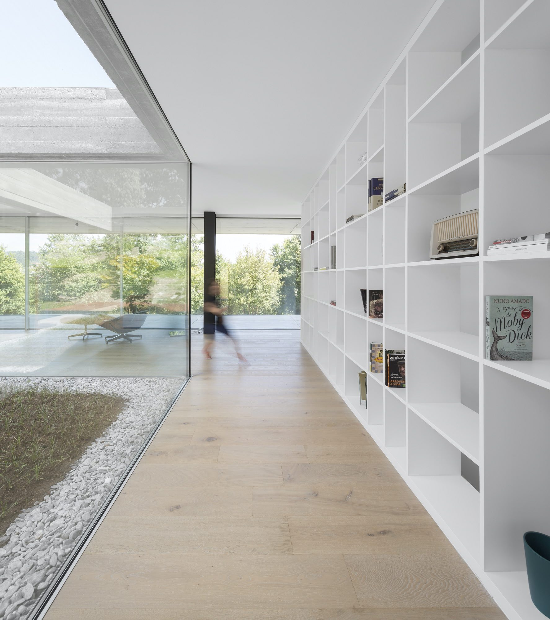 living room with large windows let the natural light enters the house